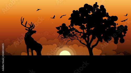 Silhouettes of deer and tree against sunset Slika na platnu