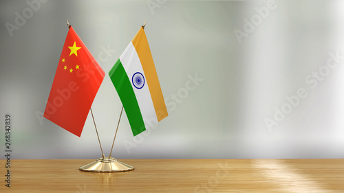 Fotografía Chinese and Indian flag pair on a desk over defocused background