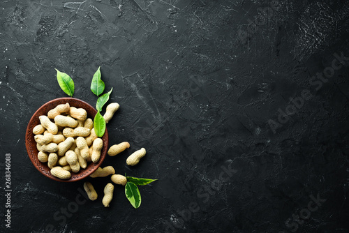 Peanuts on a black background. Nuts Top view. Free space for your text.