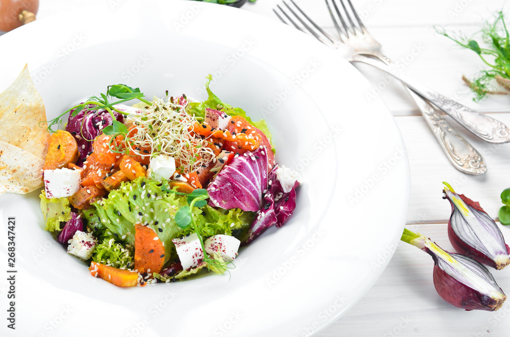 Fototapety, obrazy: Vegetable salad with cabbage with feta cheese. In the plate. Top view. Free space for your text. Rustic style.