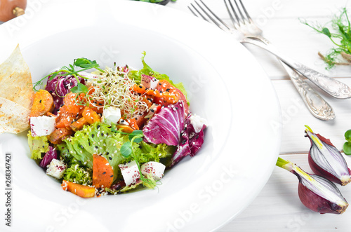 Obraz Vegetable salad with cabbage with feta cheese. In the plate. Top view. Free space for your text. Rustic style. - fototapety do salonu