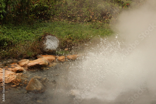 Printed kitchen splashbacks Squirrel steam rising and rolling from the bubbling boiling water of a volcanic hot spring in a beautiful national park near Pai, Northern Thailand, Southeast Asia