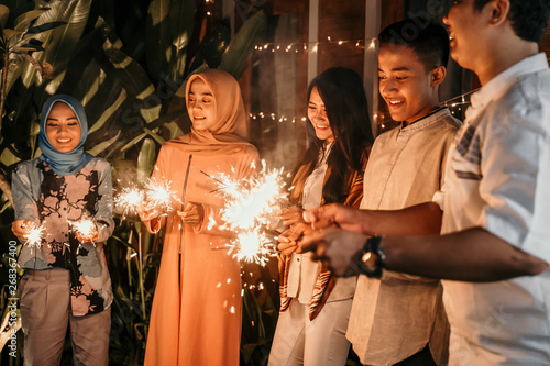 happiness lighting the takbir night fireworks with friends while celebrating the Slika na platnu