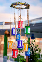Decorative Colorful Tin Boxes Hanging From The Roof