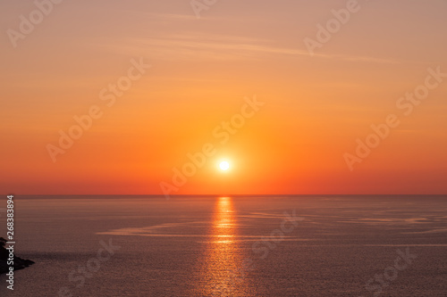 Beautiful sunset on Andaman sea at Windmill View Point near Laem Promthep Cape, Phuket, Thailand