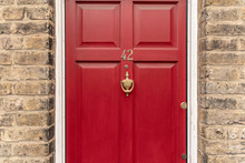 Background Of Vintage Red Painted Door And Knocker Vignette Look Made Of Old Fashioned Vintage Brass Metal