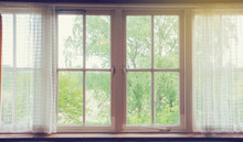 Window With Curtains And Green...