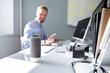 Leinwandbild Motiv Businessman Using Voice Assistant