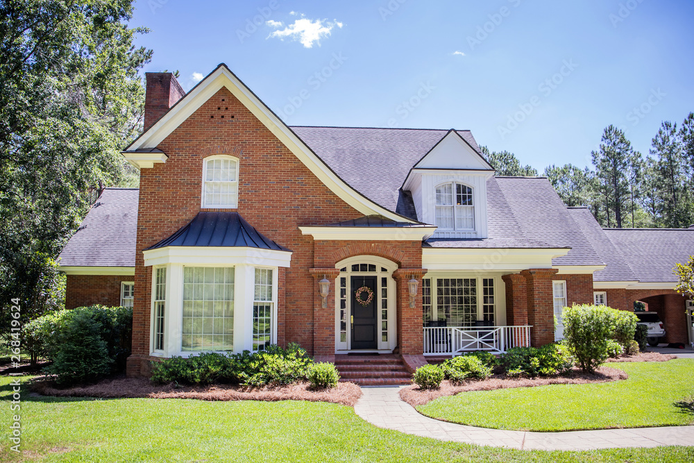 Fototapety, obrazy: Large Red Brick Traditional Colonial Home House on a large Wooded lot in the south