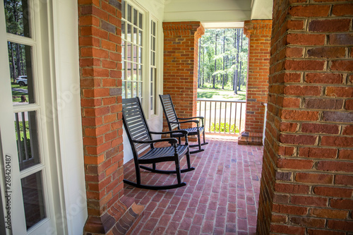 Groovy Red Brick Home Front Porch With Black Rocking Chairs Buy Bralicious Painted Fabric Chair Ideas Braliciousco