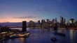 Panoramic view of Brooklyn bridge and Manhattan at night, New York City.