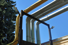 Outdoor Industrial Pipes Of Manufacturing Plant On A Sunny Day