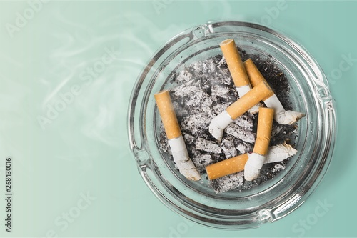 Ashtray and smoked cigarettes on backgrouund Canvas Print