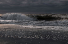 Moody Day At Long Beach Island, New Jersey, Featuring Beautiful Waves On The Foreground And Dark Sky On The Background.
