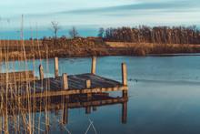 Wooden Floating Dock On A Pond