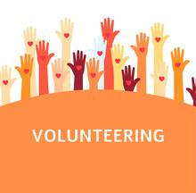 Volunteer Group With Raised Ha...