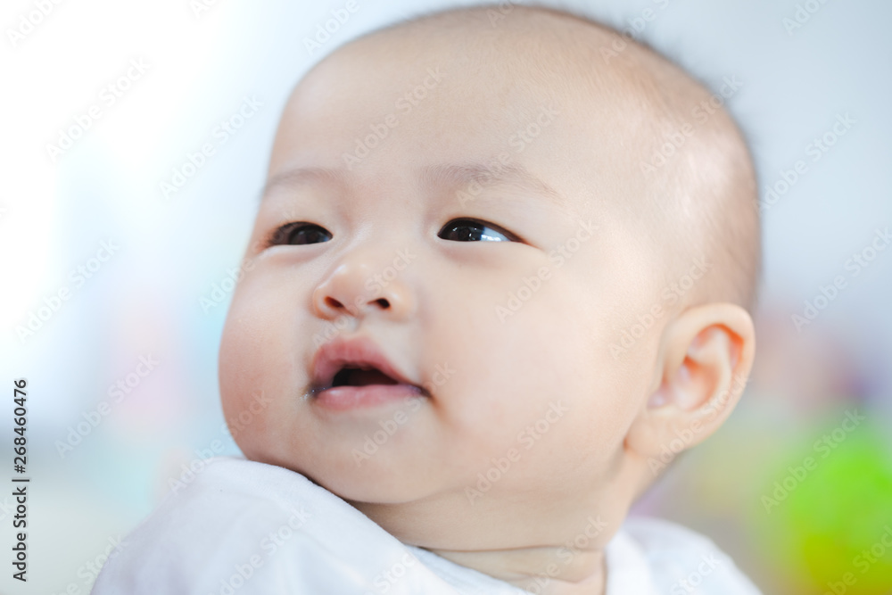 Fototapety, obrazy: Asian baby happy in the room.Asian baby girl lying down on bed .