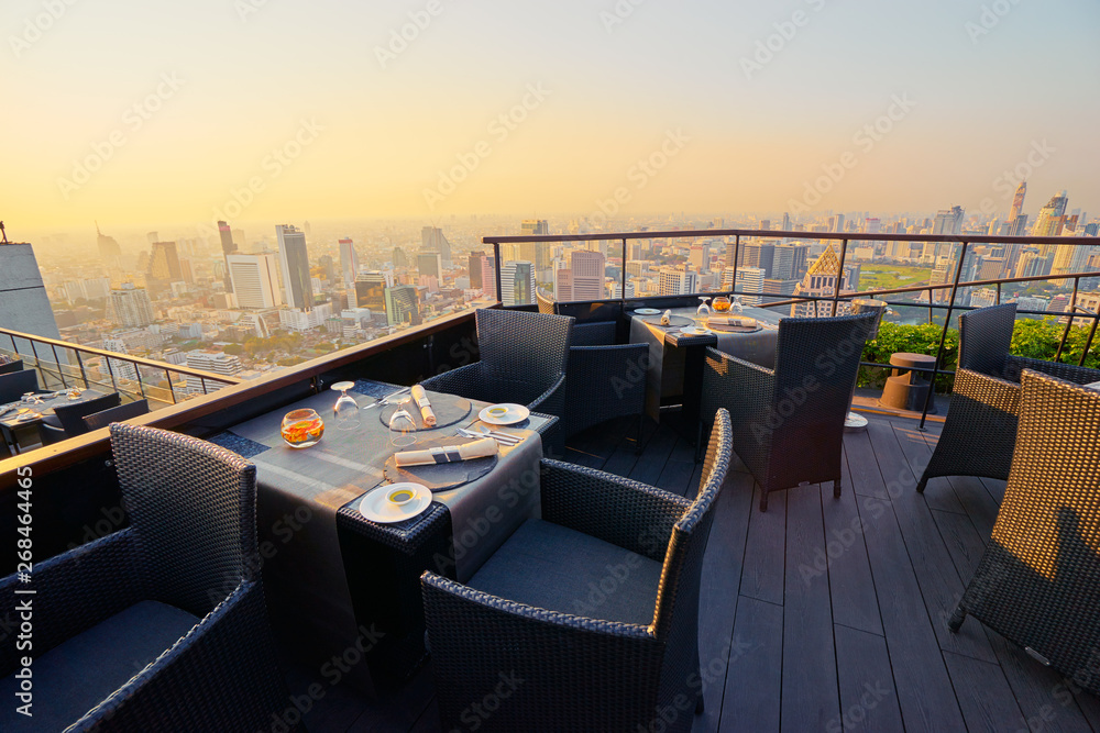 Fototapety, obrazy: Table setting on roof top restaurant with megapolis view, Bangkok Thailand.
