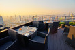 canvas print picture - Table setting on roof top restaurant with megapolis view, Bangkok Thailand.