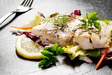 Grilled Cod Fillet With Salad On Black Slate Plate