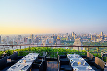 Table Setting On Roof Top Restaurant With Megapolis View, Bangkok Thailand.