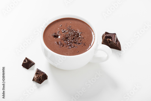 Cadres-photo bureau Chocolat Hot chocolate drinks and chocolate pieces in white cup.