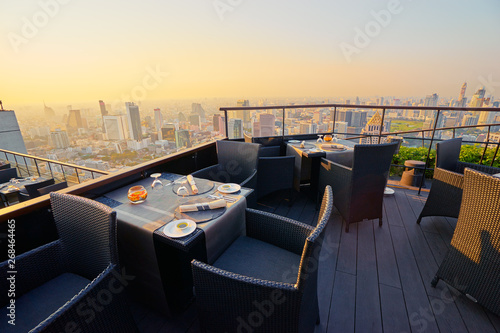 Table setting on roof top restaurant with megapolis view, Bangkok Thailand Fototapeta