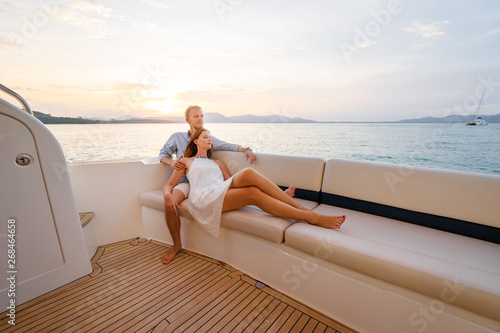 Leinwand Poster Loving couple on the yacht.
