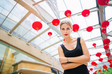 Portrait Of Pretty Young Woman Against Chinese Red Lanterns Decorations.