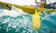 Explorer Women Paddling Hard Sea Kayak On An Ocean.