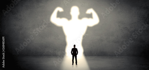Photo Businessman standing and dreaming about a strong superhero