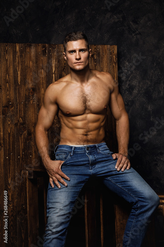 Fototapeta Portrait of handsome muscular and sexy man wearing jeans obraz