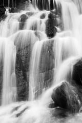 Panel Szklany Podświetlane Do łazienki Pure waterfall falling from the black precipice.