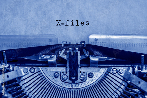 Photo  X-files printed on a sheet of paper on a vintage typewriter