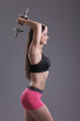 fitness woman in doing exercises with dumbells.