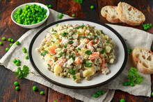 Russian Traditional Salad Olivier With Vegetables And Meat.