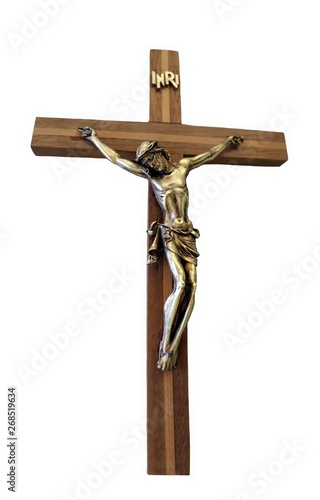 Foto Front on view of crucifix with metal figure of Christ isolated on white backgrou