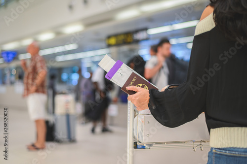 Fényképezés  Closeup of girl holding passports and boarding pass at airport