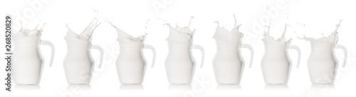 Fototapeta Milk splash in glass jug obraz