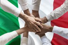 Union Or Team Hands Multcultural People Team Over Italian Flag Topview