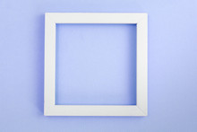 White Square Frame On A Pink Pearl Design Board.