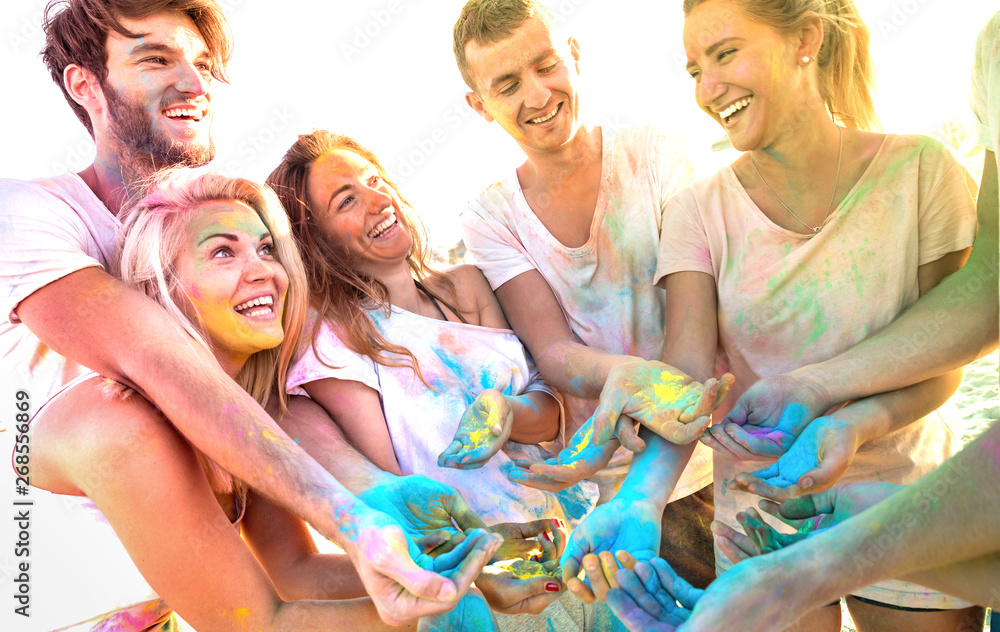 Leinwandbild Motiv - Mirko : Young friends having fun at beach party on holi colors festival - Happy people playing together with genuine carefree mood at summer event - Youth friendship concept with multi colored sunshine filter