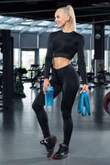 Happy fitness woman workout at the gym. Beautiful athletic girl