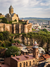 Horizontal Photo Of The Narikala Fortress And The Surrounding Architecture Of The Old Town In Tbilisi, Georgia, Caucasus, Taken On Early Morning.