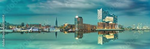 Wall Murals Music store Skyline von Hamburg mit Blick auf die Elbphilharmonie die sich im Wasser spiegelt