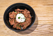 Japanese Food Gyudon - Beef On Rice, Topped With Egg On Wooden Table