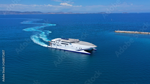 Obraz na plátně Aerial drone top view photo of high speed passenger ferry arriving at port of My