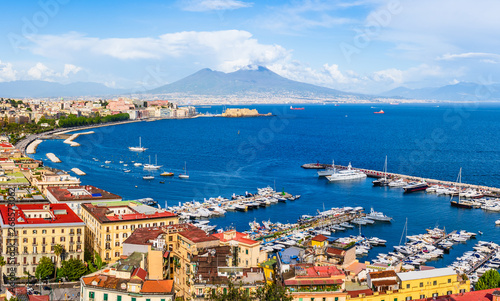 Poster Napels Naples city and port with Mount Vesuvius on the horizon seen from the hills of Posilipo. Seaside landscape of the city harbor and golf on the Tyrrhenian Sea