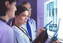 Hospital Doctors Looking At X-rays In An Emergency Room