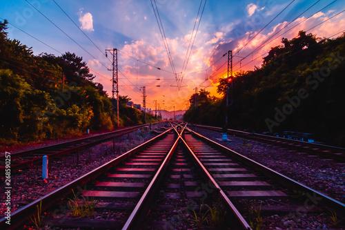 Foto auf Leinwand Eisenbahnschienen Antiquity railway at the sky of dawn